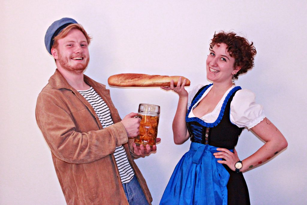 A young man with a beer, a young woman with a baguette: German and French stereotypes